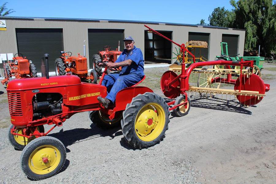 Ken Barr on his 1949 Massey Harris 30 towing a 1952 Massey Harris hay rake